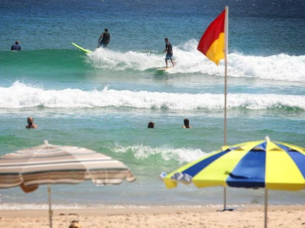 Surfers in the flags at Rainbow Bay in Coolangatta.
