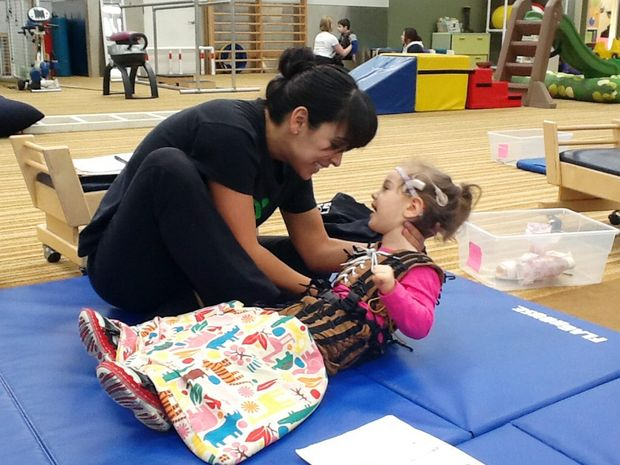 DETERMINATION: Two-year-old Gin Gin toddler Grace Lukan has cerebral palsy and is in Los Angeles undergoing three weeks of intense physical therapy with her therapist, Jess.