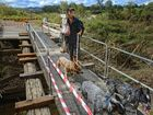 ANOTHER WORRY: Chris Skinner now has to walk over four hours carrying feed for her cattle because the recent flood washed away the Inglebar Creek bridge, her only other route. Photo Adam Hourigan