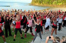 Women dance against Violence against Women at Noosa.