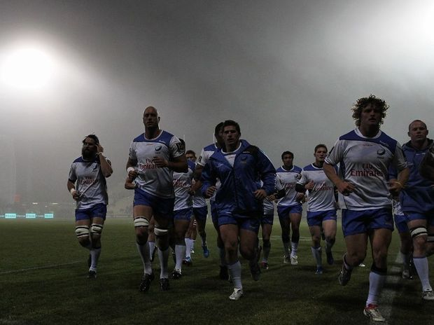Nathan Sharpe of the Western Force leads his team around the field in heavy fog prior to the start of round 18 Super Rugby match between the Crusaders and the Force on July 14, 2012 in Christchurch, New Zealand.