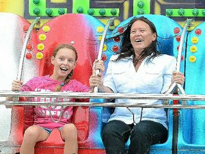 SHOW FUN: Elizabeth Saunders and daughter Amanda enjoy the Let's Go ride.