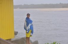 Commercial fisherman Paul Grenfell at Noosa as heavy rain falls across the Coast.