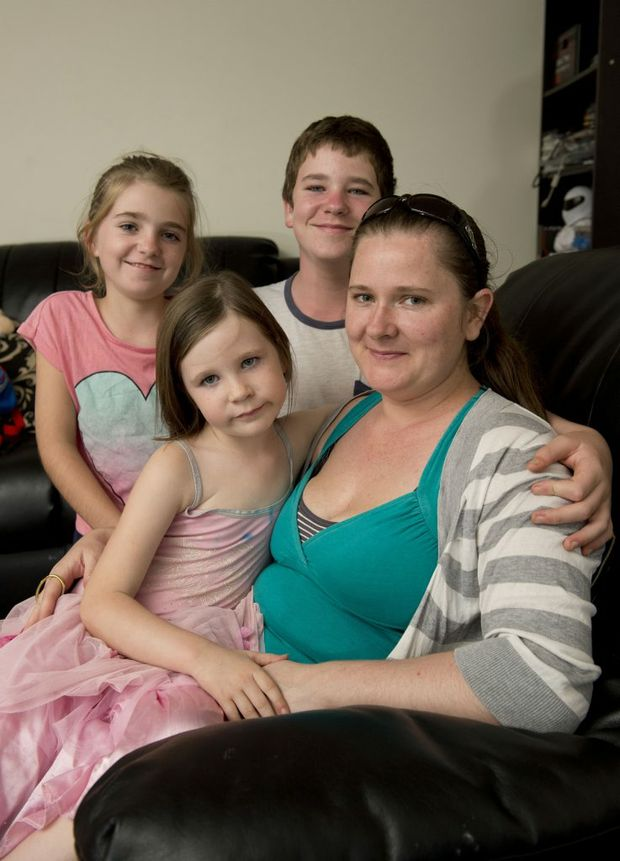 Mum Emily Cooke, with Zoe-Maree, Jake and Gabriel, says her children are eager to get to school everyday.