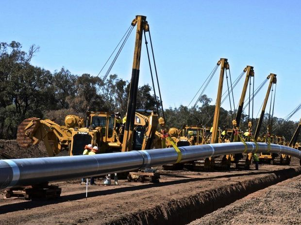 Australia Pacific LNG's main transmission pipeline going into the ground. Photo Contributed