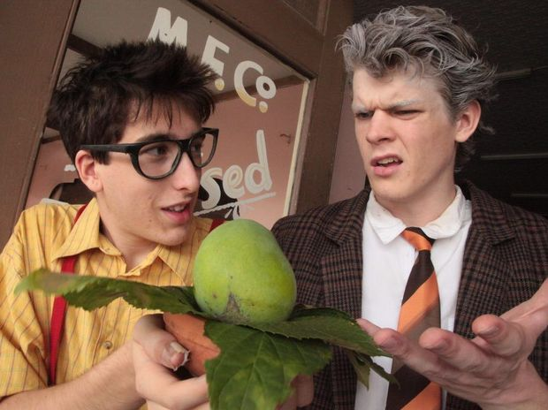 Chris Hubac (Seymour) and Aaron Devine (Mr.Mushnik) look over the Audrey II Bud.
