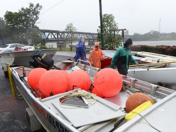 Clarence River Sailing club members take their boats out of the club sheds as the river rises Photo Adam Hourigan / The Daily Examiner