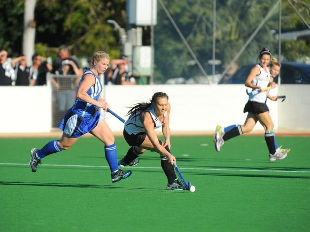 LADIES FINAL: All Blacks' Stacey Neller passes the ball as Cities' Emily Robinson looks on. Photo: Mike Knott / NewsMail