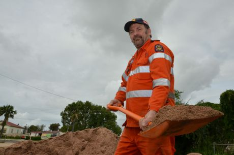 MAN AT WORK: Kingaroy SES Unit deputy local controller Paul Adams has been hard at work filling sandbags throughout the floods. Photo Jordan Philp / South Burnett Times