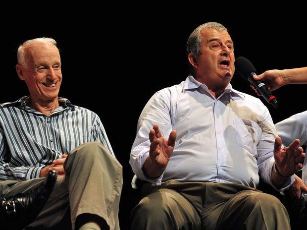 Jeff Nuske (right) talks as Bob Ansett(left) listens at the public forum on deamalgamation at the J.
