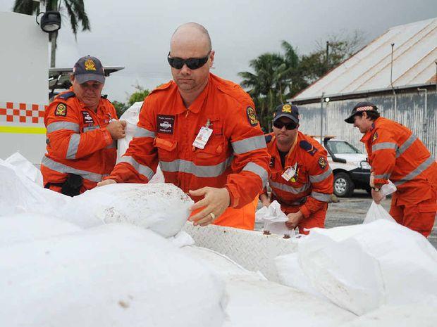 Graham Jackson, Brett Larsson, Ben Taylor and Jo Ann Clout prepare sandbags.