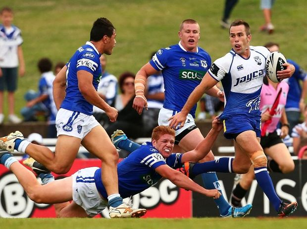 Steve Turner of the Bulldogs makes a line break during the NRL trial match between the Canterbury Bulldogs and the Newtown Jets at Belmore Sports Ground on February 10, 2013 in Sydney, Australia.