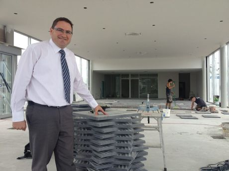 Wippells Autos dealer principal David Russell stands in the under-construction Audi showroom, due for unveiling in three weeks' time.