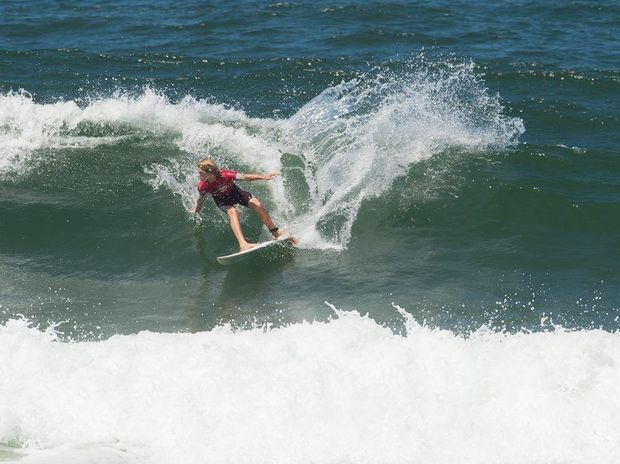 Local surfers tore up the big swell at Sawtell Beach as part of the Barney Miller Classic.