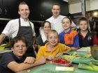 Chef Ryan McBurney and Angel Cafe owner Rick Osbourne with Edible Gardens cook-off competitors (from left) Nick Covus, Amber Peasley, Tia Osman, Grace Callow and Max Orbell.