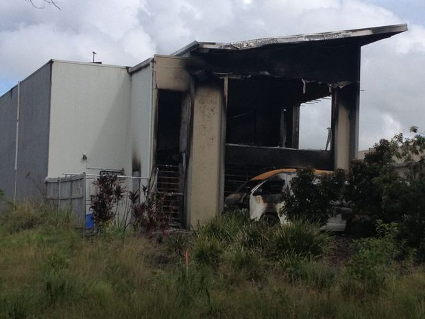 The burnt-out Rebels bikie gang clubhouse.