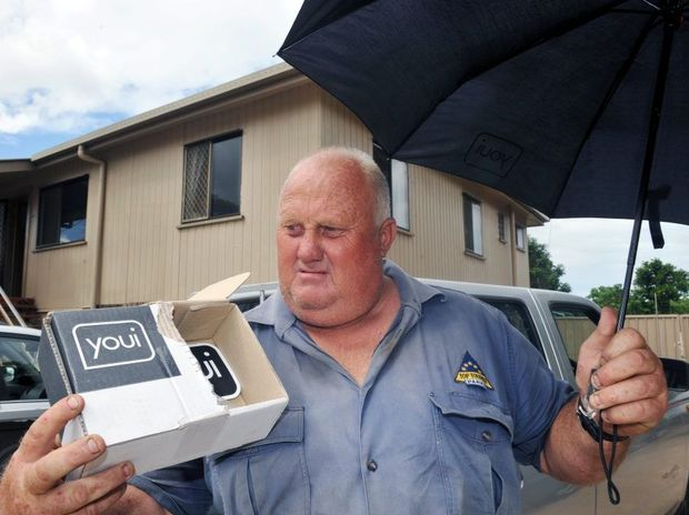 BAFFLES ME: Tom Orpin wonders what Youi was thinking when they sent him an umbrella in sympathy for the devastation his family suffered in the recent flood. Photo: Max Fleet / NewsMail