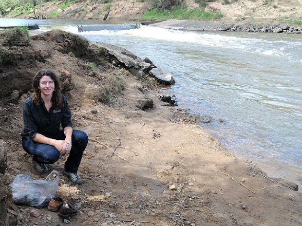 Mary River Catchment Co-ordinating Committee worker Tanzi Smith beside a damaged Mary River.