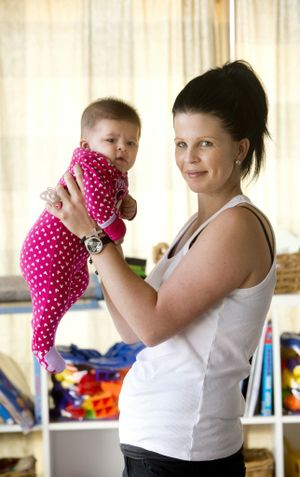 Melissa Sutton with baby Savannah. Melissa hopes to win competition for cosmetic surgery in Thailand. Photo Nev Madsen / The Chronicle