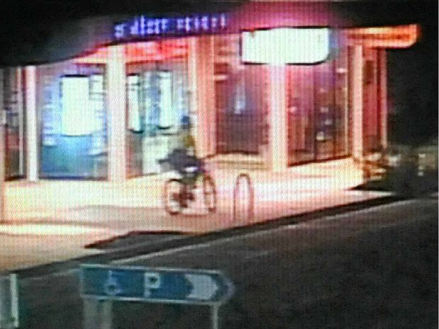 CAUGHT ON CAMERA: CCTV footage shows a man on a bicycle firing two shots through the glass windows of Inside Outside Body Art.