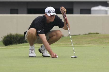 IN LINE: Burnett Cup players Rod Moore lines up his pump on the 9th green at the Bundaberg Golf Club. PHOTO: Sandy McLeod
