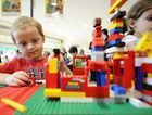 Brock Fuller works to construct the elaborate house he built out of Lego at Grafton Shoppingworld.