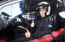 READY TO ROLL: Brendan Young, 15, was the happy passenger in a V8 Supercar at Queensland Raceway on Saturday.