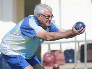 Hervey Bay bowls club - Reg King from Hervey Bay lines up his next shot.