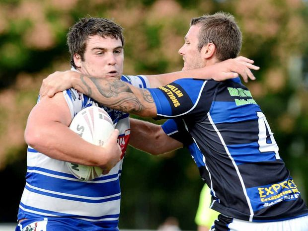 QUICK STEP: Brothers lock Sam Krueger and Goodna centre Joel Bennett do the tango in last Sunday's IRL clash at Goodna.