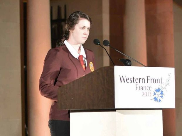 FAULTLESS: McCauley Catholic College student Caitlin Nash reads the Ode of Remembrance at Menin Gate.