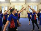 Downlands College dance students Caitlin Hawkins, Kobi James and Isobel Harber learn some new ballet skills under instruction from Queensland Ballet EdSquad dancers.