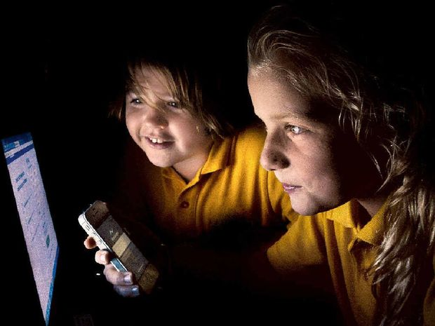 SOCIAL SUPERVISION: Blair Ryan, 11, of Goonellabah, and Taylah Reddell, 11, of Wollongbar, have their use of social media monitored by their parents.