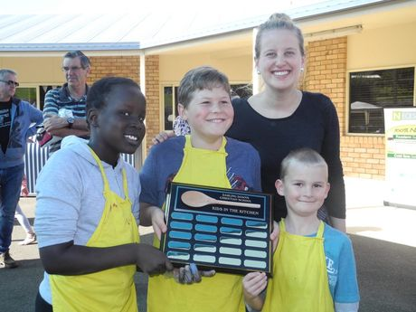 Abouc Mawien, 9, Patrick Bolt, 11, and Jesse Higgins, 7, were all smiles after they won the cooking competition judged by Masterchef finalist Ellie Paxton-Hall.