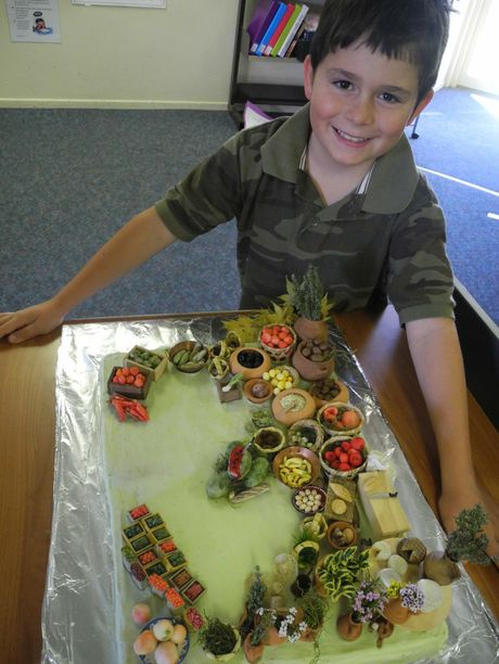Daniel Stanfield, 8, with his winning entry in the cake decorating competition.