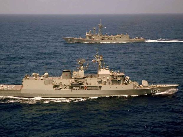 HMAS Toowoomba and HMAS Newcastle conduct their Operation SLIPPER handover and officer of the watch manoeuvres in the northern Indian Ocean
