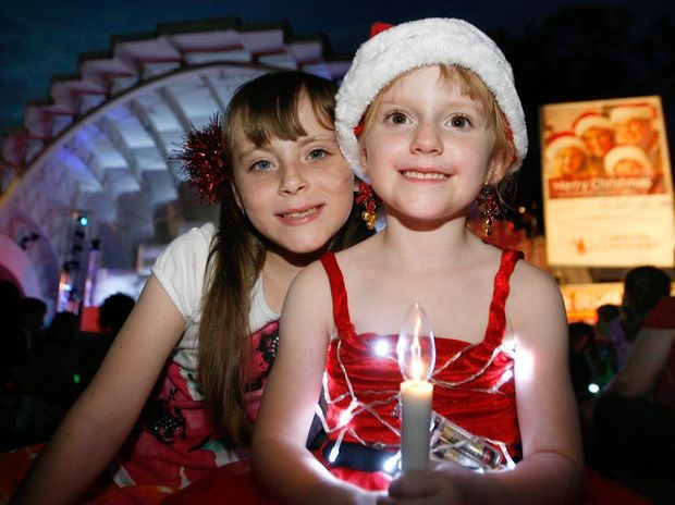 Bella Whitlock (7) and Hollie Webb (5) at the Rockhampton Carols by Candlelight in 2011.
