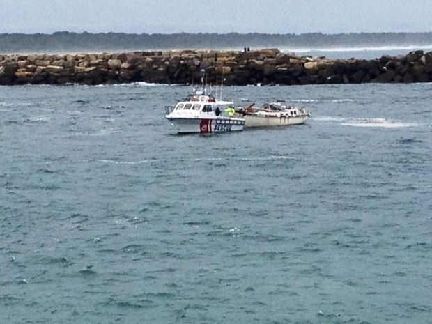 Two people were rescued from an overturned vessel at Yamba.