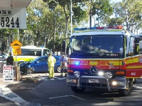 Ambulance and fire officers at the scene of a single-vehicle crash on the Esplanade at Torquay.
