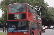 Magician Dynamo appears to levitate on side of London bus