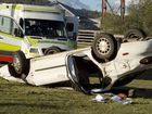 Car rolled at corner of New England Highway and Hodgsonvale Rd. Photo Nev Madsen / The Chronicle