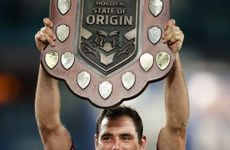 Maroons captain Cameron Smith holds aloft the State of Origin trophy after victory during game three of the ARL State of Origin series at ANZ Stadium on July 17, 2013.