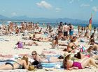 Tourism shines as confidence wanes