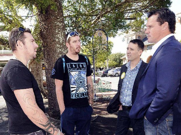 CAMPAIGN TRAIL: Tod and Ned Gray of Lismore speak with Palmer United Party candidate for Page Stephen Janes and NSW Senate lead candidate Matthew Adamson.