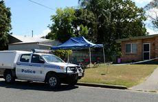 Rockhampton Police officers set up a crime scene at a North Rockhampton unit in Tomkys St, Berserker.