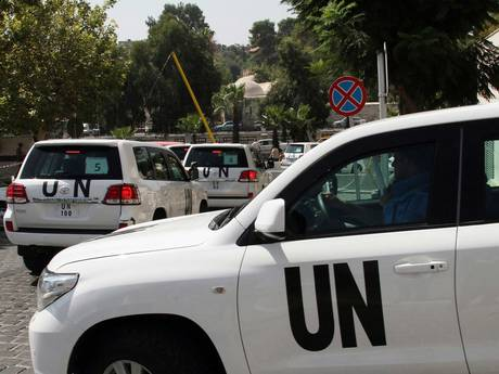 The convoy of UN cars in Syria