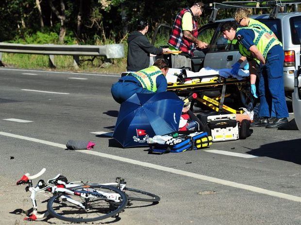 Paramedics attend a cyclist hit by a car on Noosa Eumundi Road near the corner of Beddington Road.