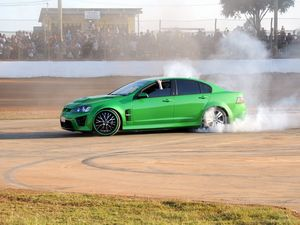 This VE Holden Commodore got the crowd on their feet with a marvellous burnout at the Maryborough Speedway. Photo: Hayden Johnson/ Fraser Coast Chronicle
