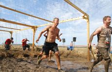 Competitors tackle the 2013 Tough Mudder event on the Sunshine Coast. Taking on Electroshock Therapy. Photo: Warren Lynam / Sunshine Coast Daily