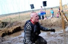 Competitors tackle the 2013 Tough Mudder event on the Sunshine Coast.