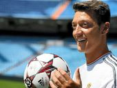 ARSENAL smashed its club transfer record yesterday when it signed German playmaker Mesut Ozil,  from Real Madrid, for $A73 million.